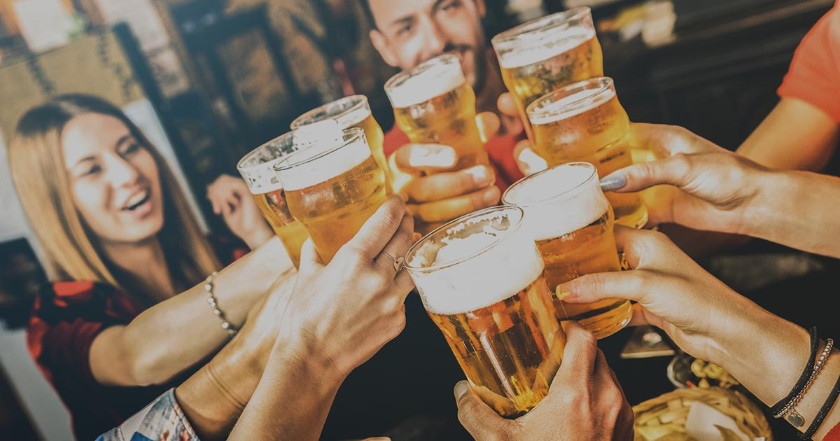 group of people clinking beer glasses together